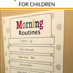 Printable Morning Routine chart for kids hanging on wall.
