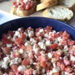Tomato feta greek dip in blue bowl