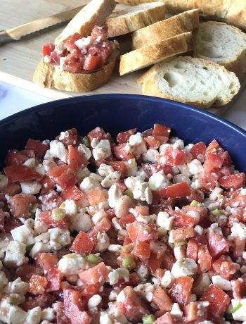 Tomato feta greek dip in blue bowl