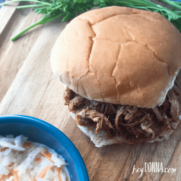Instant Pot Pulled Pork Recipe - Pulled Pork Sandwich on cutting board