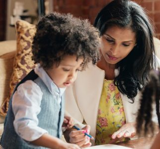 Mother drawing with anxious child