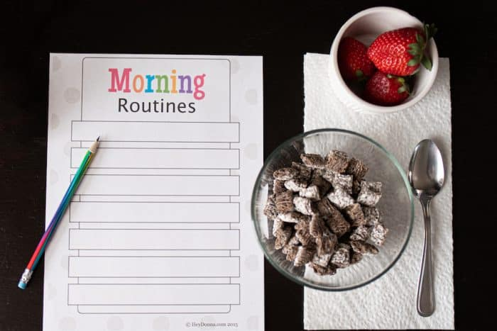 Morning Routine chart for kids on table with breakfast before school.