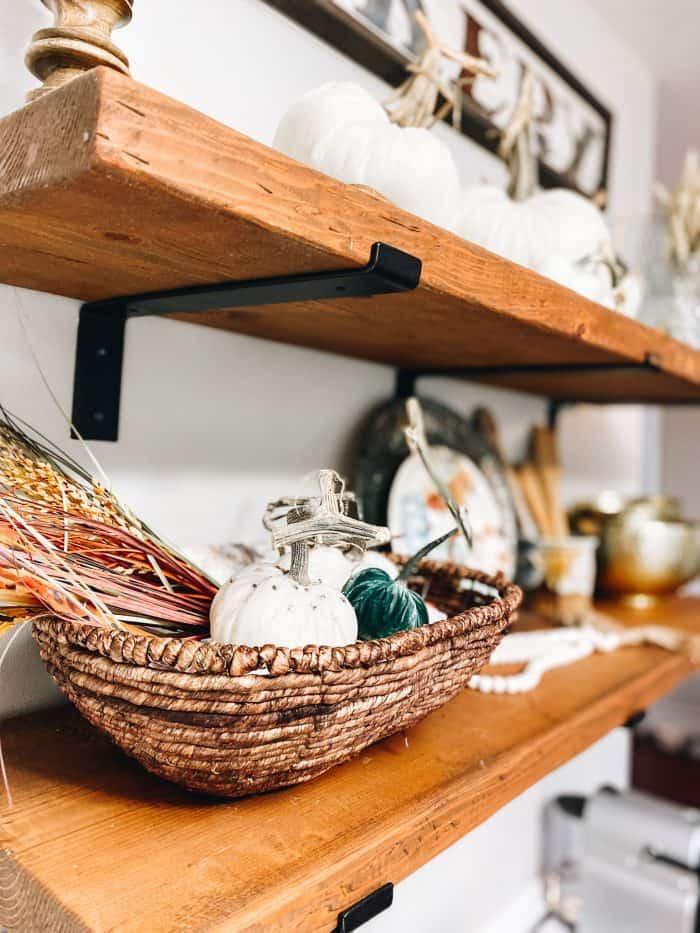 Velvet pumpkins in a basket on a Fall Farmhouse Shelves