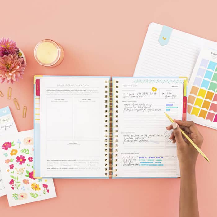Woman writing in goal planner. - A Goal Without a Plan is Just a Wish and lessons about goal planning.