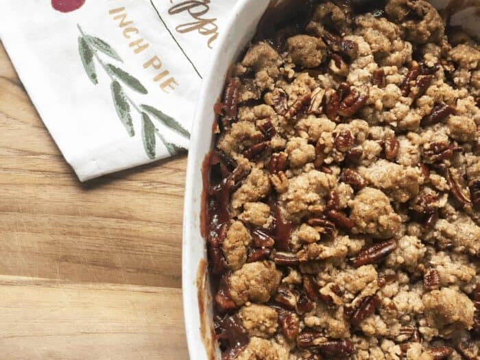 Apple and Cherry Crumble Dessert on cutting board.